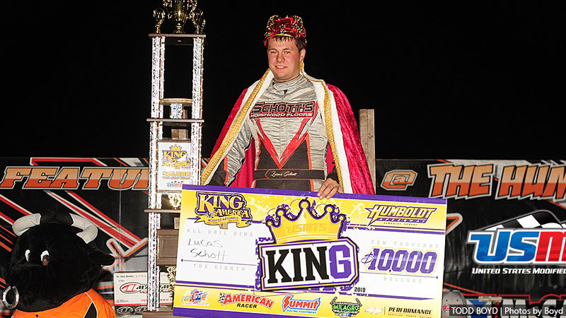 Schott wears King of America VIII crown