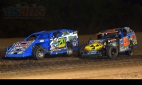 Current Gressel Racing driver Tanner Mullens leads former Gressel Racing driver Ricky Thornton Jr. during the feature race at the inaugural USMTS event at the Salina Speedway in Salina, Kan., on Thursday, June 8, 2017.