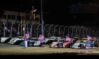 Four-wide parade lap at the 2nd Annual USMTS Chubbs Performance Midweek Modified Madness at the Ogilvie Raceway in Ogilvie, Minn., on Wednesday, June 14, 2017.