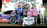 Joe celebrates in victory lane with family and friends after winning the USRA Modified feature at the Lucas Oil Speedway in Wheatland, Mo., on Thursday, June 29, 2017.